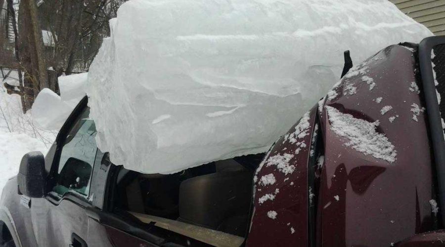 фото автомобиля поврежденного снегом
