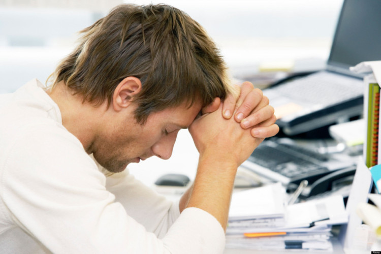 BEBKFY Young man in an office leaning on desk